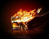 stock photo of absinthe  - Image of two glasses of burning yellow absinthe - JPG