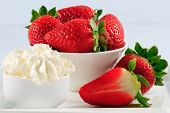 Strawberry, dessert - strawberries and whipped cream in the white bowl