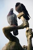 Pigeons Sitting On The Sculpture
