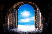 image of gates heaven  - Dark tunnel corridor with arch opening to the sun - JPG