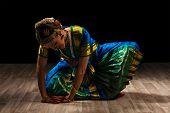 foto of bharata-natyam  - Young beautiful woman dancer exponent of Indian classical dance Bharatanatyam - JPG