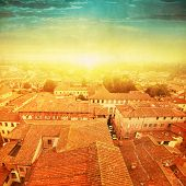 Lucca at sunset. Tuscany. Italy.Grunge and retro style.