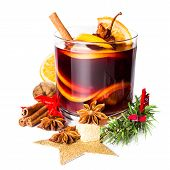 Glass With Hot Red Mulled Wine For Winter And Christmas With Orange Slice, Anise And Cinnamon Sticks