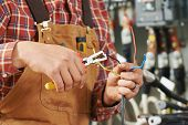 pic of electrical engineering  - hands of electrician builder engineer worker with electric equipment and wire - JPG