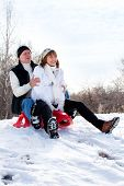 picture of sled  - Mature couple sledding - JPG