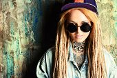 picture of dreadlocks  - Modern teenage girl with blonde dreadlocks over grunge background - JPG