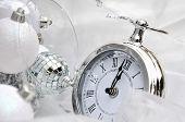 image of pendulum clock  - silver clock retro style overlooking midnight with Chrsitmas balls - JPG