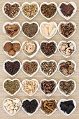 foto of tatar  - Large chinese herbal medicine selection in heart shaped porcelain bowls over bamboo background - JPG