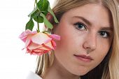 image of nose piercing  - Portrait of a young blonde girl with nose piercing and rose - JPG