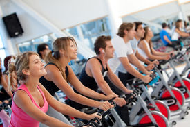 picture of cardio exercise  - Group of gym people on machines - JPG