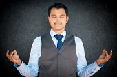 stock photo of stress relief  - Closeup portrait of handsome young man in vest and tie in meditation zen mode isolated gray black background - JPG