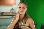 stock photo of molar  - Young hispanic girl with toothache and dental problems feeling pain when drinking cold water - JPG