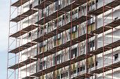 foto of scaffold  - Contemporary office building construction site with scaffolding - JPG