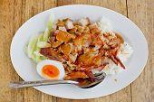 stock photo of pork  - BBQ Pork and Crispy Pork over Rice with Sweet Gravy Sauce  - JPG