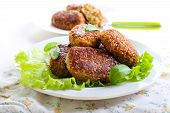 image of patty-cake  - Fish cakes fried in bran crumbs on plate - JPG