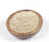 picture of quinoa  - Uncooked quinoa in the wooden bowl - JPG