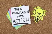 stock photo of bulletin board  - Turn knowledge into action phrase pinned on bulletin board - JPG