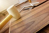 picture of laminate  - tools to laying laminate rubber hammer and wooden plates