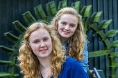 picture of water-mill  - Close up of two caucasian teenage girls in front of water mill - JPG