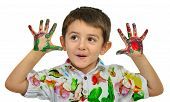 foto of finger-painting  - Little boy painting with hands with different color paint on his palms - JPG