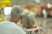 image of backside  - Beautiful elderly couple backside in shopping mall - JPG