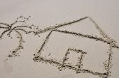 stock photo of beach-house  - Beach house concept drawn in the sand - JPG