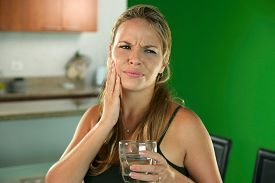 image of cold drink  - Young hispanic girl with toothache and dental problems feeling pain when drinking cold water - JPG