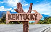 pic of bluegrass  - Kentucky wooden sign with road background - JPG