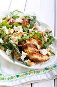 stock photo of rocket salad  - Zucchini rocket feta and nut salad on plate - JPG