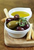 pic of kalamata olives  - black and green olives in oil with herbs - JPG