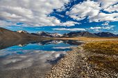 stock photo of chukotka  - Reflection in mountain lake in Chukotka - JPG