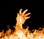 stock photo of fire  - Fire hand rising from the fire - JPG