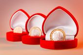 picture of ten  - Red gift boxes with one euro ten roubles and one cent coins - JPG