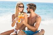 foto of cocktail  - happy couple drinking a cocktail at the beach - JPG