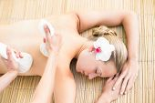 picture of day care center  - Attractive young woman getting massage on her back at spa center - JPG