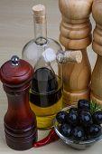 pic of vinegar  - Olive oil and vinegar bottles with pepper mill served berries - JPG