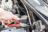 stock photo of pliers  - The process of repair wiring car using pliers - JPG