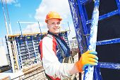 picture of millwright  - construction builder worker at building site  - JPG