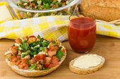 foto of tomato sandwich  - Bread with chopped vegetables herbs tomato juice sandwich and salad in bowl - JPG