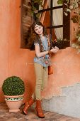 stock photo of country girl  - Young girl in country style near the window - JPG