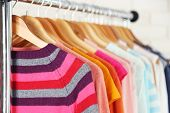 stock photo of clothes hanger  - Different clothes on hangers close up - JPG