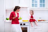 foto of helping others  - Mother and child bake a pie - JPG
