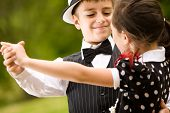 image of waltzing  - Lovely young couple dancing and having fun - JPG