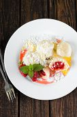 image of curd  - Vertical photo with top view on white plate with fruit dumplings sprinkled with curd and sugar - JPG