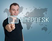 picture of helpdesk  - Young man press digital Helpdesk button on interface in front of him - JPG