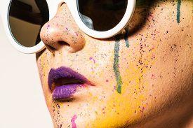 stock photo of queer  - Portrait of model wearing sunglasses - JPG
