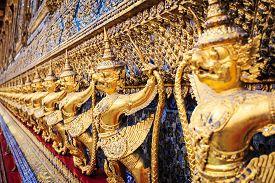 image of garuda  - Golden garuda statues at Wat Phra Kaew in Grand Palace Bangkok Thailand - JPG