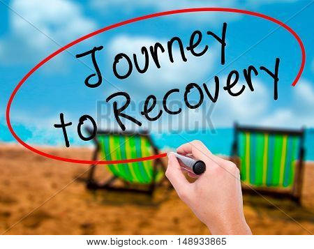 Man Hand Writing Journey To Recovery With Black Marker On Visual Screen