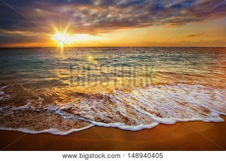Beach holidays vacation background - calm ocean during tropical sunrise