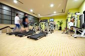 stock photo of gym workout  - Man running on treadmill in gym - JPG